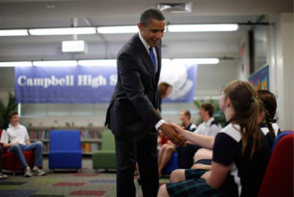 President Obama shaking the hand of a Campbell High students when he visited the school